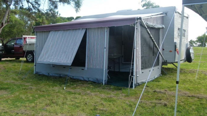 Camping with caravan awnings at night